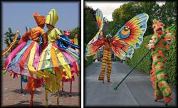In farbigen Kostümen flanieren die Stelzenläufer wie Raupen und Schmetterlinge