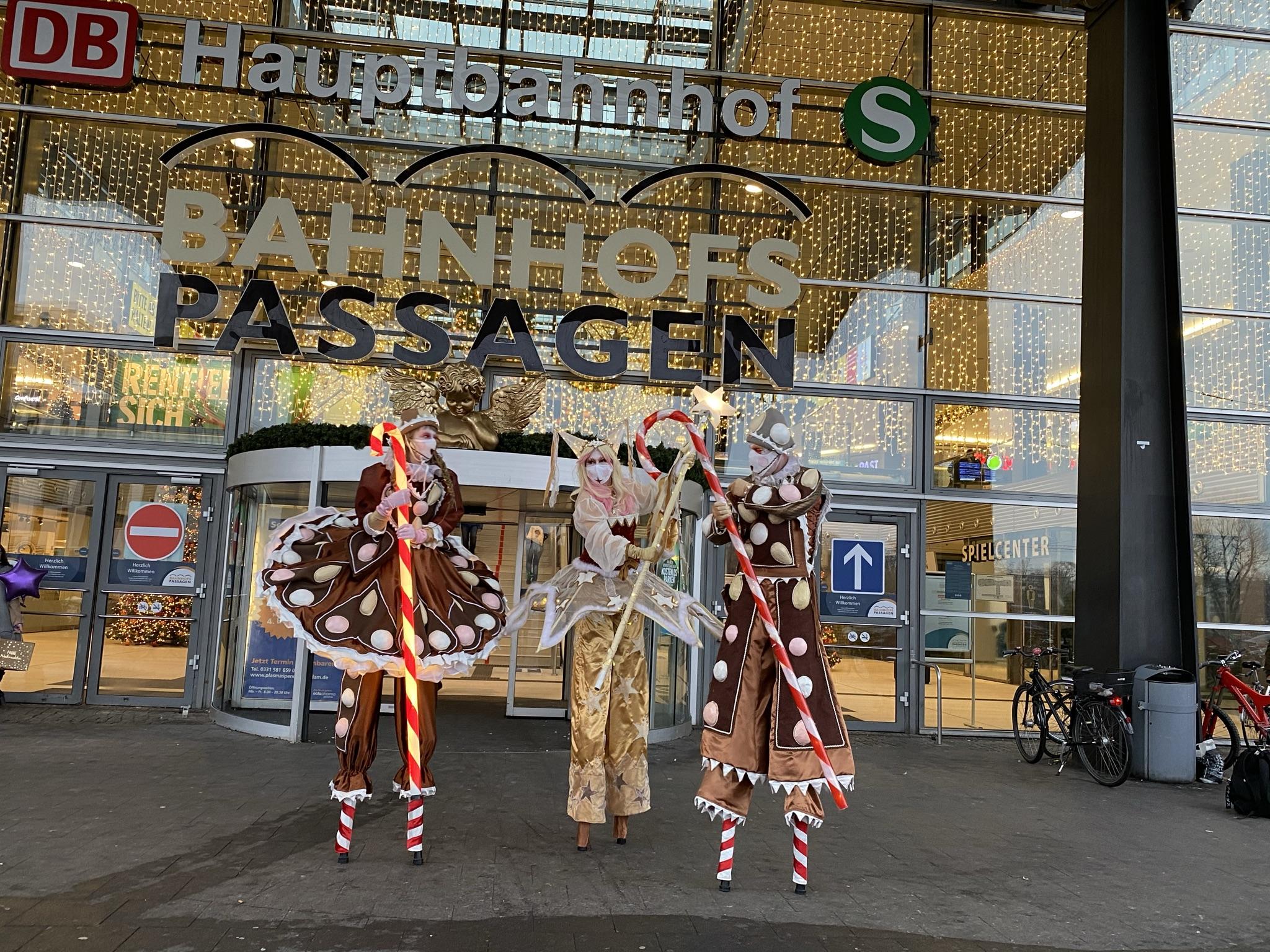 Stilt walkers in Christmas costumes