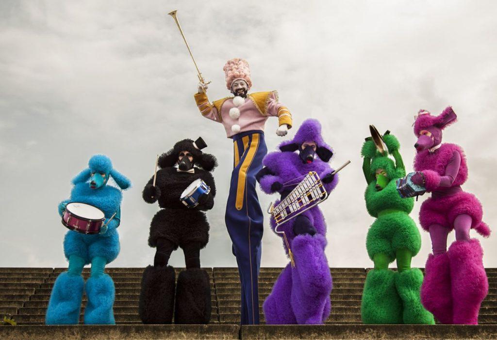 Poodle-Musicians-on-stilts-with-Mask